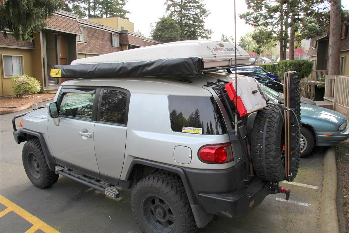 Corey s 2007 fj cruiser build up thread page 9 yotatech forums - Compare Below In The First Picture When The Rotopax Were Upright You Can Clearly See The Eezi Awn Swing Arm Is Lower Than The Cans Thus Why I Had To